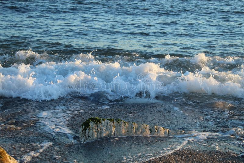 Beautiful wild beach with azure sea, waves on the shore in Tuscany, Italy. Sunny day at the beach royalty free stock photo