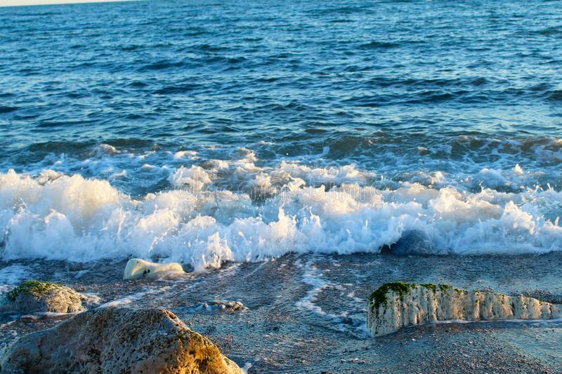 Beautiful wild beach with azure sea, waves on the shore in Tuscany, Italy. Sunny day at the beach royalty free stock photos