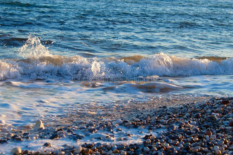 Beautiful wild beach with azure sea, waves on the shore in Tuscany, Italy. Sunny day at the beach royalty free stock photography