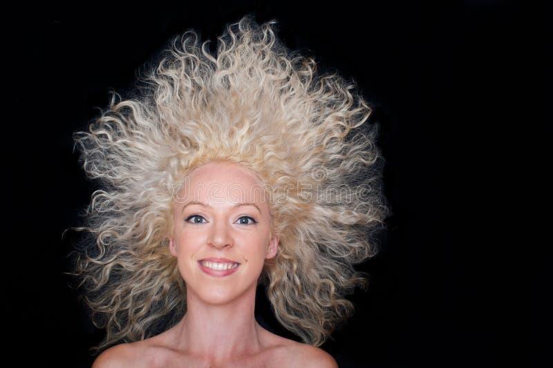 Beautiful wild hair woman. On black background royalty free stock photos