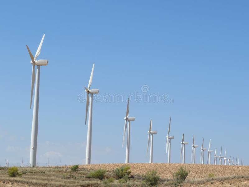 Beautiful wind turbines ready to convert the air the energy royalty free stock photography