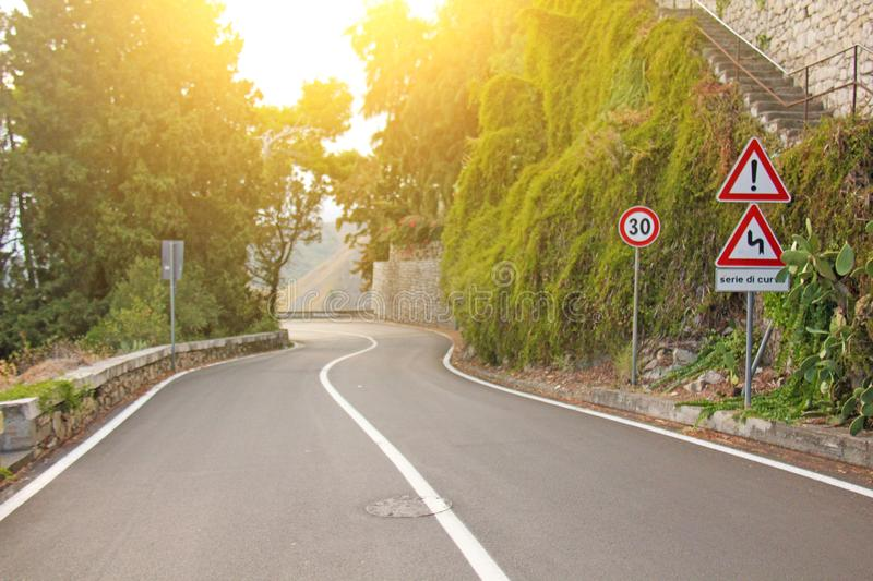 Beautiful Winding and Picturesque Green Road in the City of Taormina. The island of Sicily, Italy royalty free stock images
