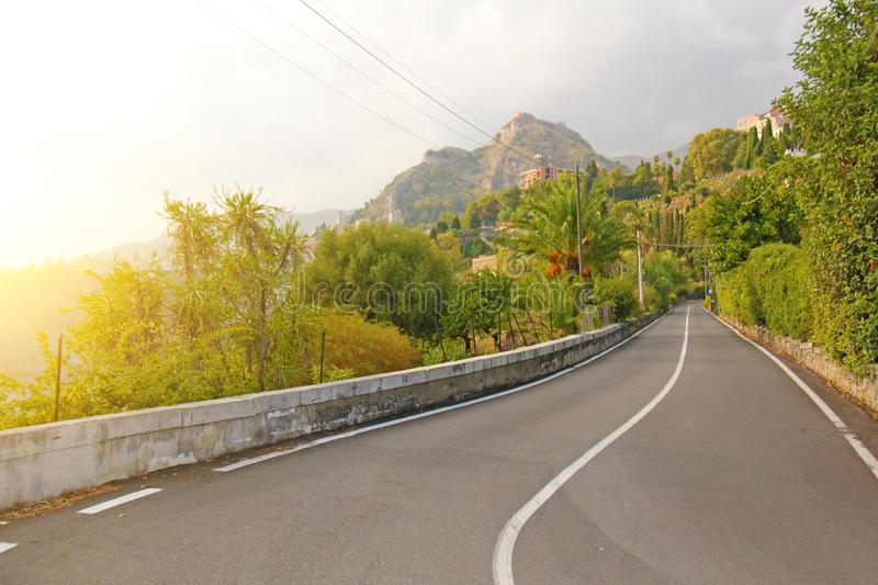 Beautiful Winding and Picturesque Green Road in the City of Taormina. The island of Sicily, Italy royalty free stock photography