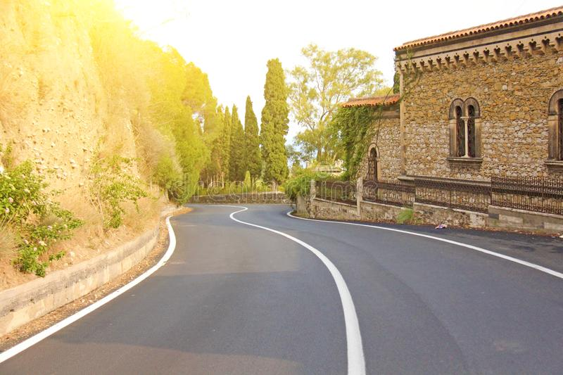 Beautiful Winding and Picturesque Green Road in the City of Taormina. The island of Sicily, Italy stock photography
