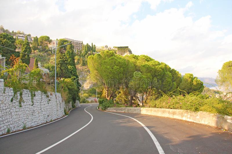 Beautiful Winding and Picturesque Green Road in the City of Taormina. The island of Sicily, Italy royalty free stock photo