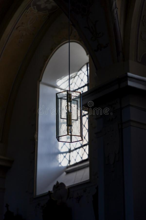 Beautiful window and a lamp in the german catholic church. Light and shadow, details. Pilgrimage Church Wallfahrtskirche royalty free stock images