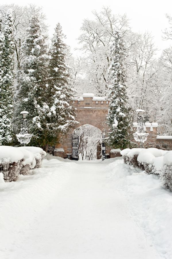 Gates of royal palace in Sigulda covered with winter snow stock image