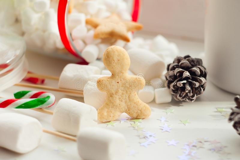 Beautiful winter composition on windowsill with ginger bread man. royalty free stock image