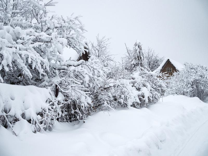 Beautiful winter countryside landscape. Snow so much that filled up the road and houses stock images