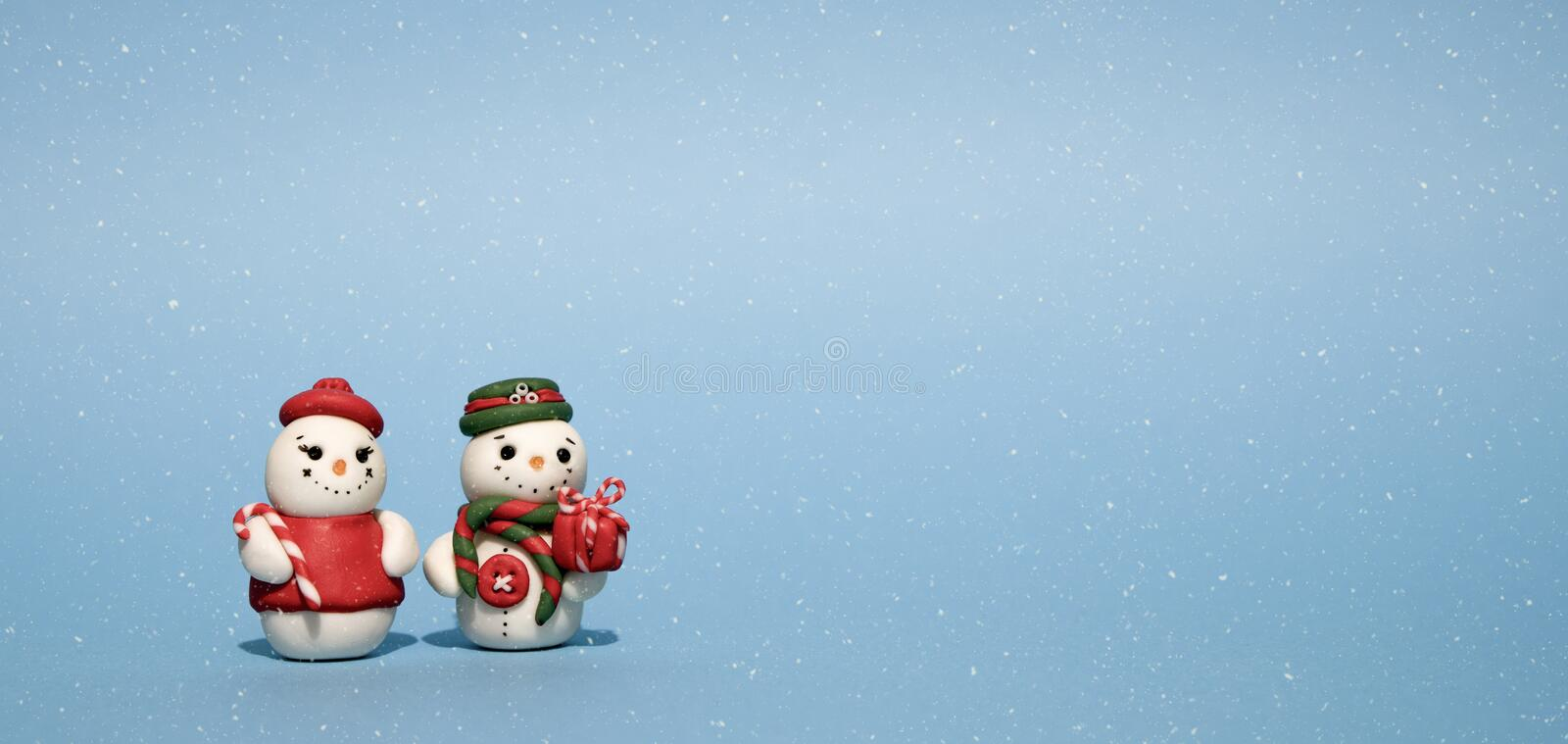 Winter Holidays background with a snowman, Gifts, snow and snowflakes royalty free stock photography