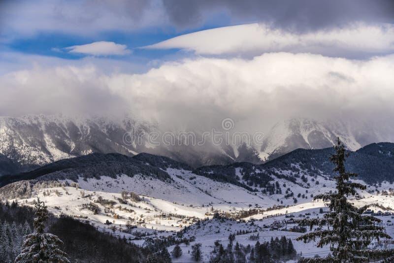 Winter landscape with Carpati Piatra Craiului mountain. Beautiful winter landscape with Carpati Piatra Craiului mountains in Romania stock photo