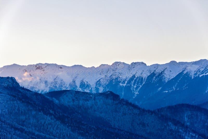 Winter landscape with Carpati Piatra Craiului mountain. Beautiful winter landscape with Carpati Piatra Craiului mountains in Romania royalty free stock image