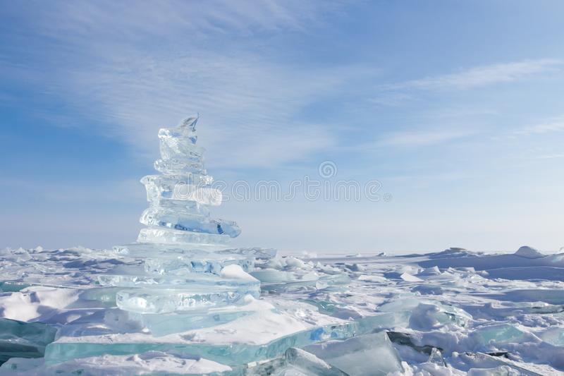 Winter Landscape. Crystal clear ice chunks. Pyramid of clear ice of Lake Baikal royalty free stock photo