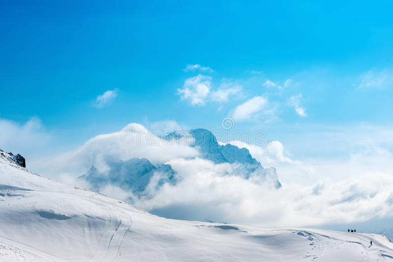 Beautiful winter landscape of Dombaj with blue sky, clouds and d royalty free stock photography