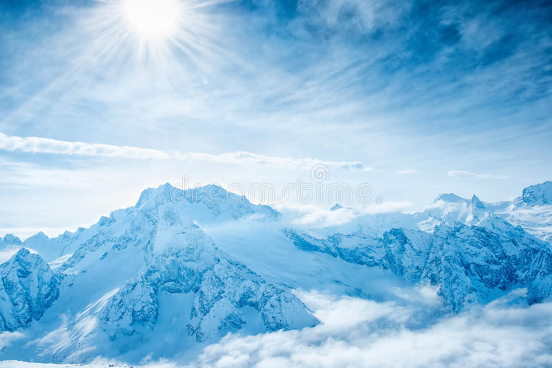 Beautiful winter landscape of Dombaj mountains higher than cloud royalty free stock photography