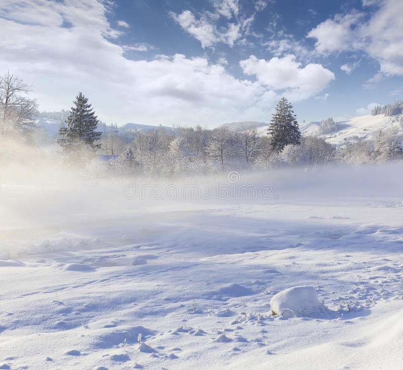 Beautiful winter landscape in mountain village. Beautiful winter landscape in the mountain village. Foggy morning stock photo