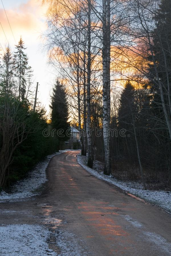 beautiful winter landscape wit road to sunset. Dirty bad road. royalty free stock photos