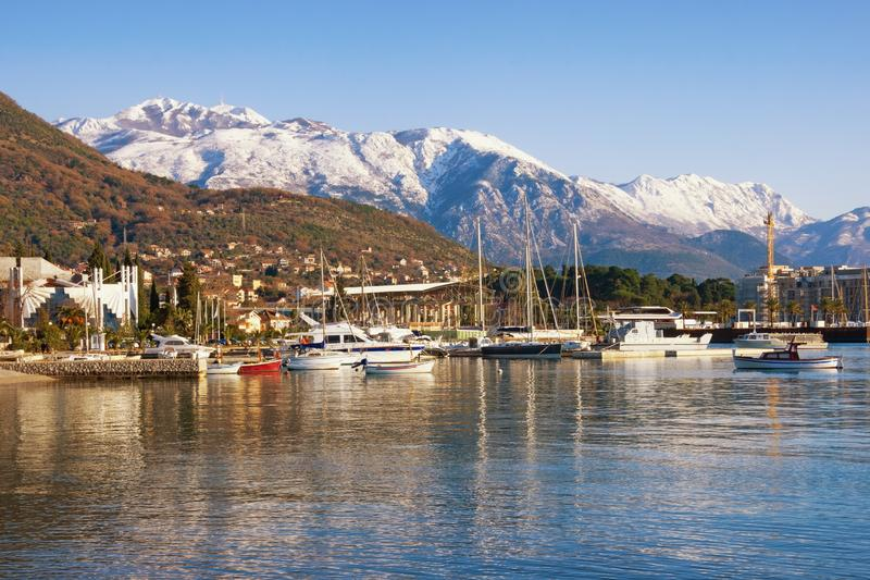 Beautiful winter Mediterranean landscape. Montenegro, Bay of Kotor. View of snowy Lovcen mountain and Tivat city stock photo