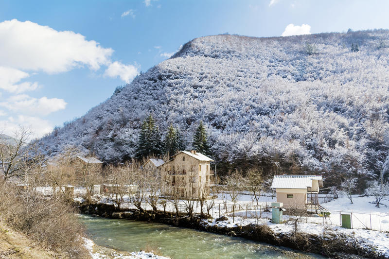Beautiful Winter mountain landscape from Bulgaria. Beautiful Winter mountain landscape - snowy Mountain,river and houses royalty free stock photos