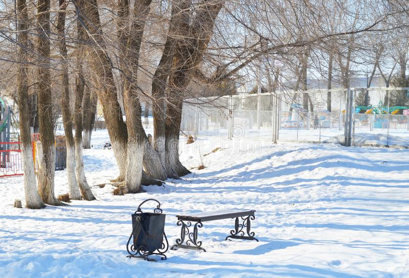 Beautiful winter park. Trees and bench. Romantic atmosphere. Beautiful winter park with snow trees and bench. Romantic mood and beautiful shadows royalty free stock photo