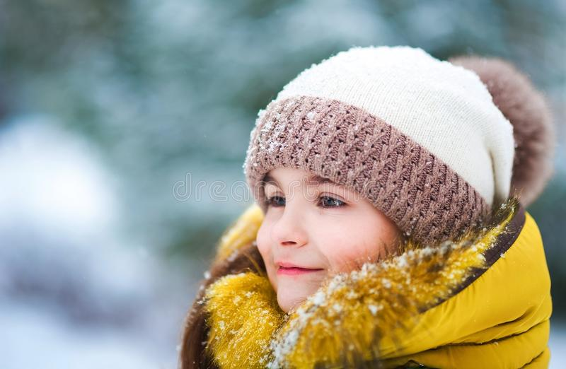 Beautiful winter portrait of a child outdoors. Face of girl close-up royalty free stock photo