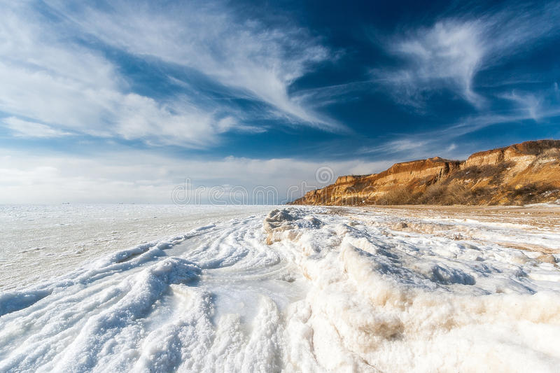 Beautiful winter seascape. Black Sea is covered with ice. royalty free stock image