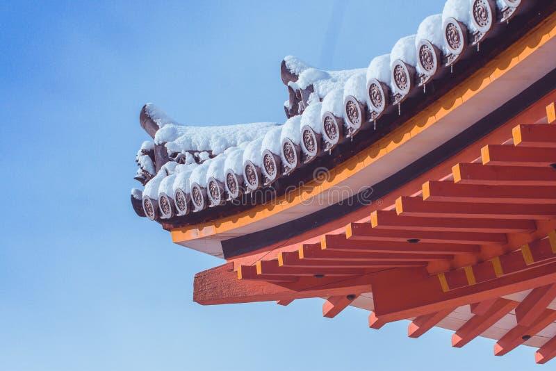 Beautiful winter seasonal image corner of Red Pagoda at Kiyomizu-dera temple covered white snow with blue sky background. Beautiful winter seasonal image corner stock photography