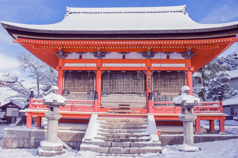 Beautiful winter seasonal of Red Pagoda at Kiyomizu-dera temple surrounded with trees covered white snow background at Kyoto. Beautiful winter seasonal of Red royalty free stock images