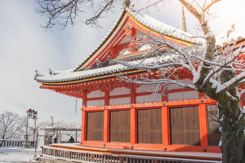 Beautiful winter seasonal of Red Pagoda at Kiyomizu-dera temple surrounded with trees covered white snow background at Kyoto. Beautiful winter seasonal of Red stock image