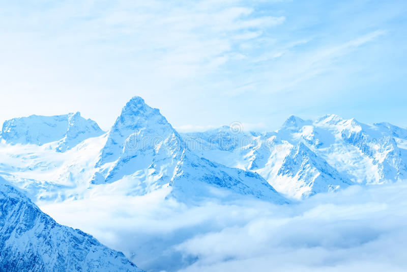 beautiful winter snow covered peaks of Caucasus mountain, Dombaj over clouds, Russia, close up royalty free stock photos