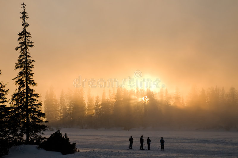 Beautiful winter sunset. Enjoing the beautifull natural game of lights royalty free stock photo