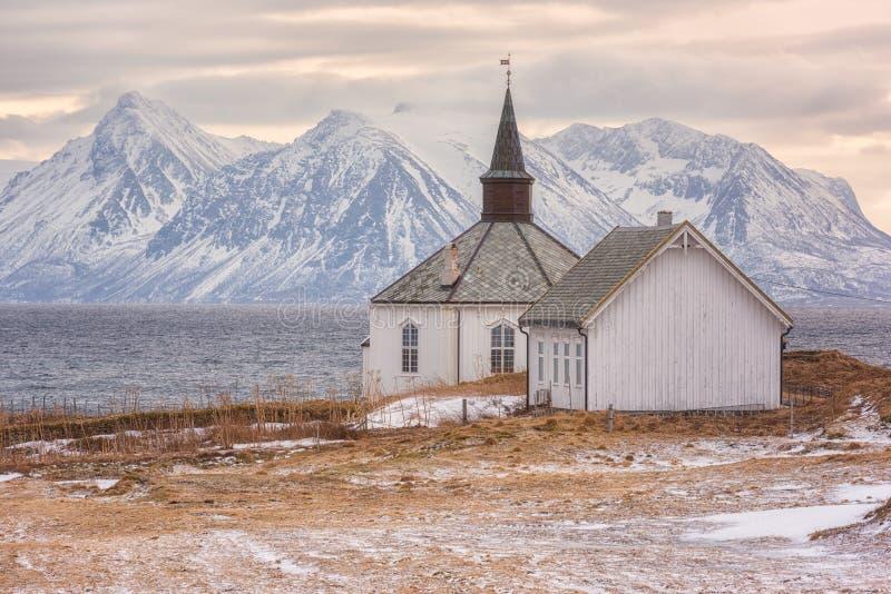 Beautiful winter sunset landscape, lonely church on the seacoast, Lofoten Islands, Norway royalty free stock image