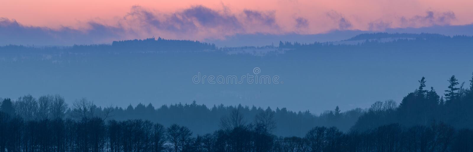 Beautiful Winter sunset in the mountain valley. Winter sunset in the mountain valley europe poland sudety peaks mountains forest trees clouds snow end day stock images