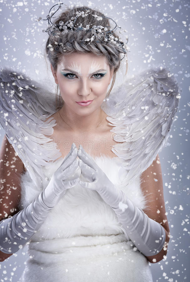 Beautiful winter woman. With malicious smile royalty free stock photography