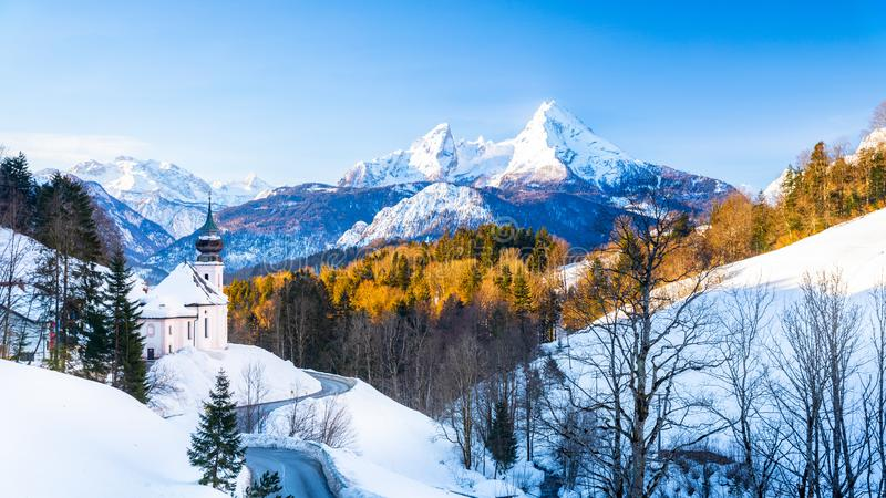 Beautiful winter wonderland mountain scenery in the Alps with pilgrimage church of Maria Gern and famous Watzmann summit in the. Background, Berchtesgadener royalty free stock image