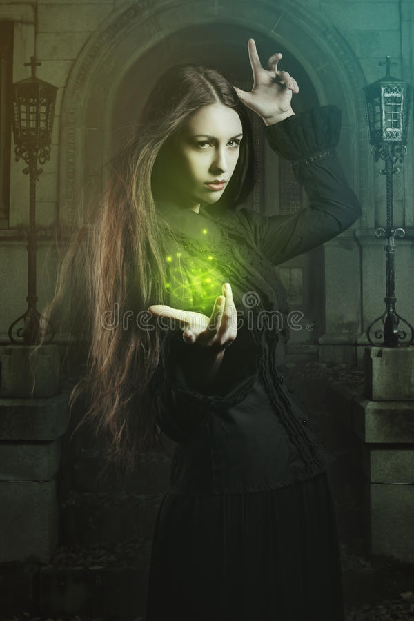 Beautiful witch casting a spell stock photos