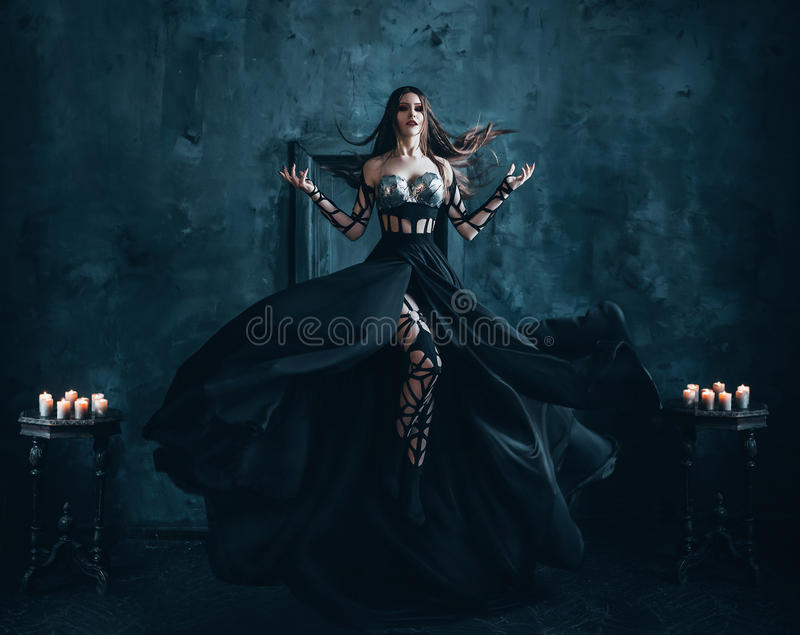 Beautiful witch floating in the air stock photos
