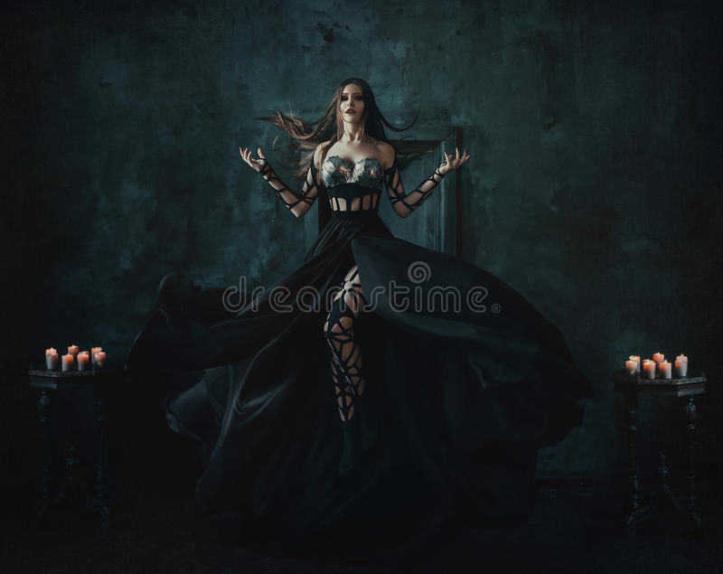 Beautiful witch floating in the air stock image