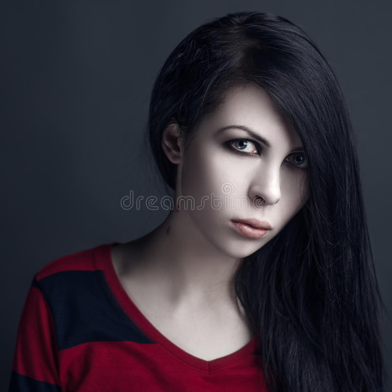 Beautiful witch and Halloween theme: portrait of a girl vampire with black hair royalty free stock photography