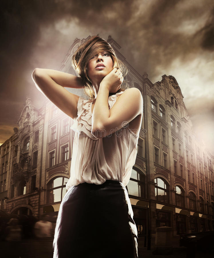 Beautiful woman. Fine art photo of a beautiful woman in front of a building