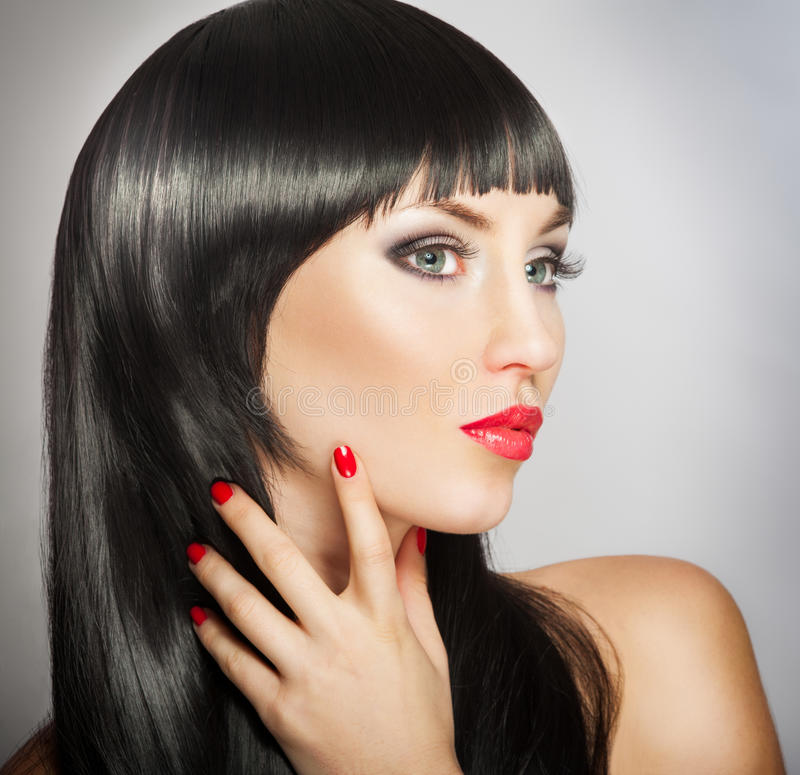 Beautiful woman. Woman with bright red lips and manicure, black hair stock photos