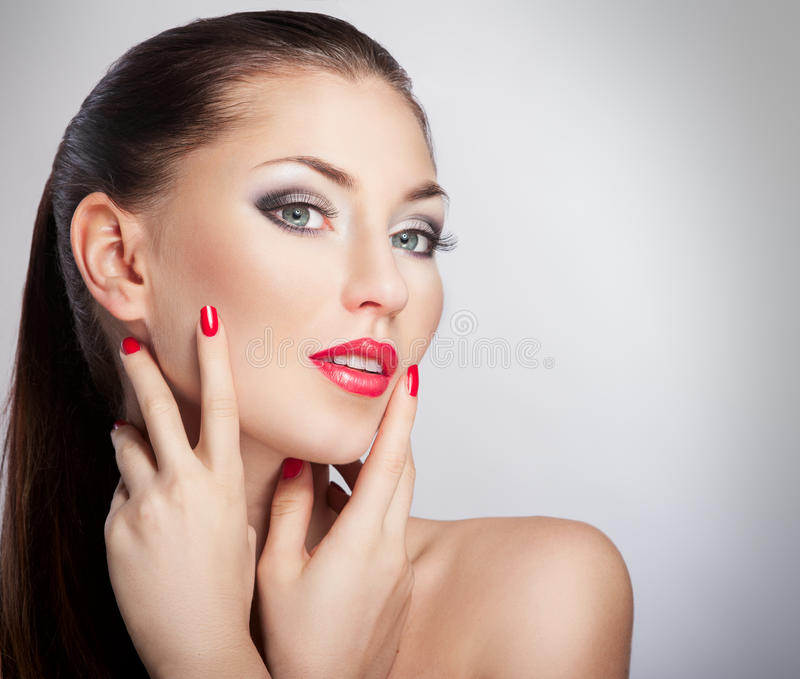 Beautiful woman. Woman with bright red lips and manicure stock images