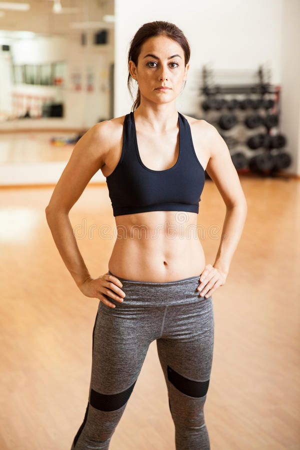 Beautiful woman with abs in a gym stock image