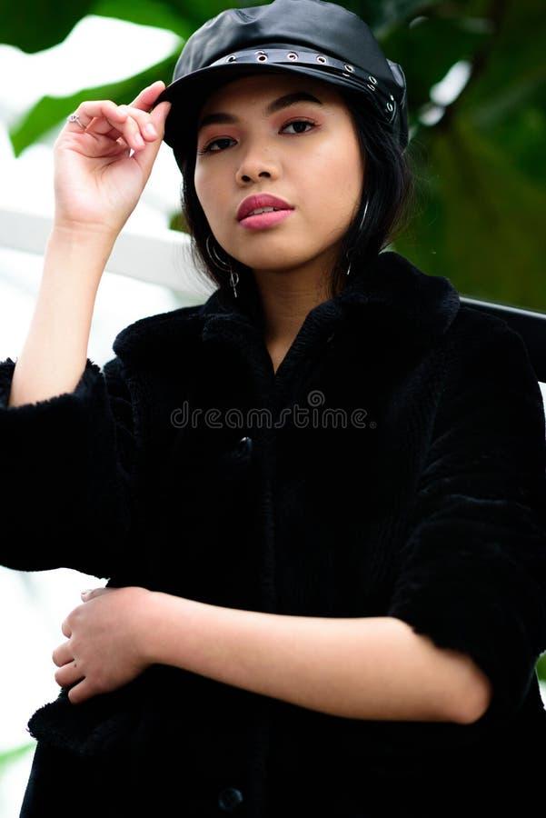 Beautiful woman adjusting her cap stock photo