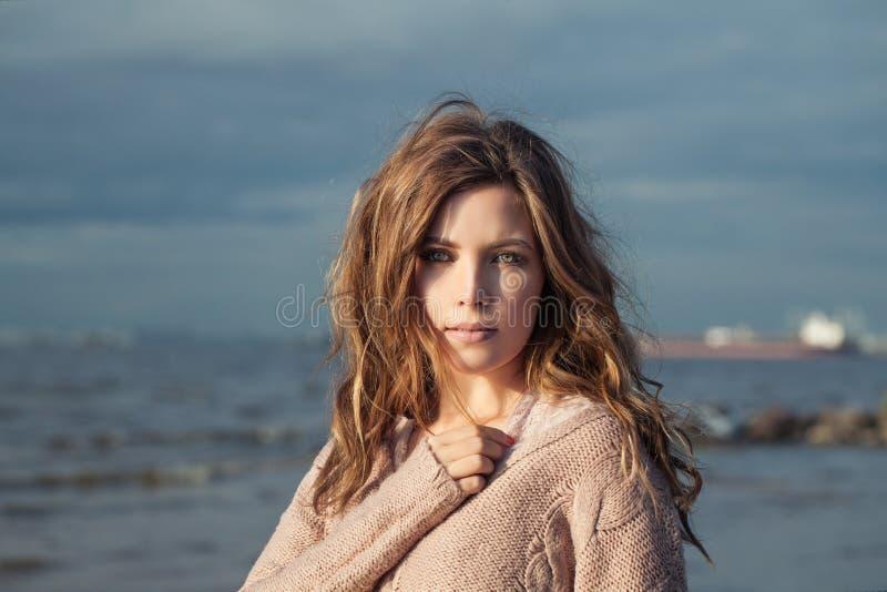 Beautiful woman against blue ocean and sky.  stock photos