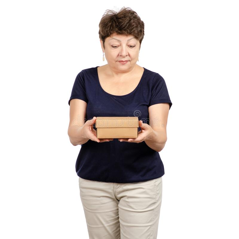 Beautiful woman aged is holding a box stock image