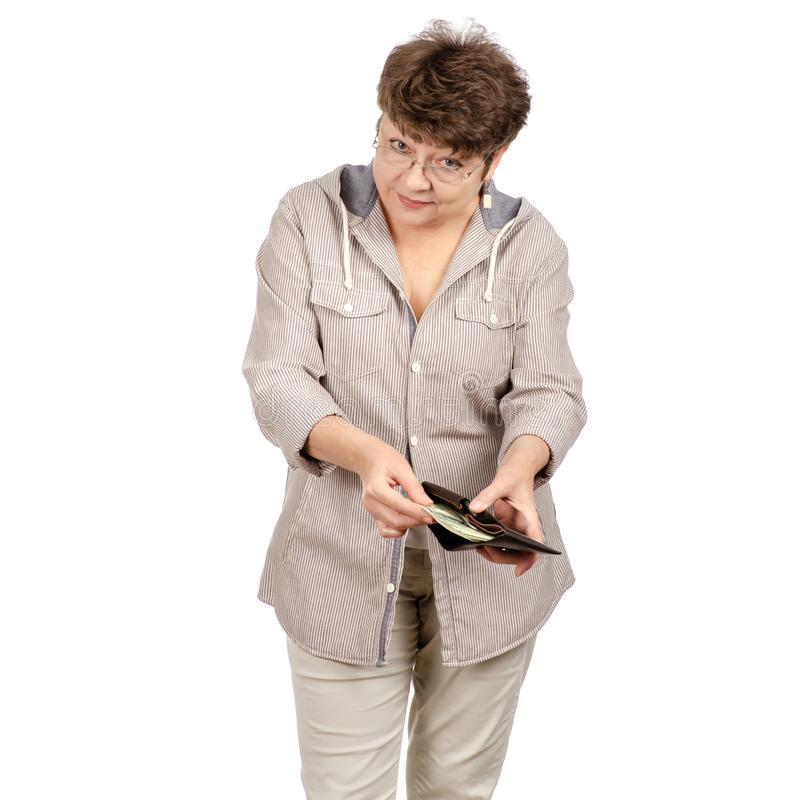 Beautiful woman aged smiling with glasses a money dollars purse in her hands royalty free stock photography