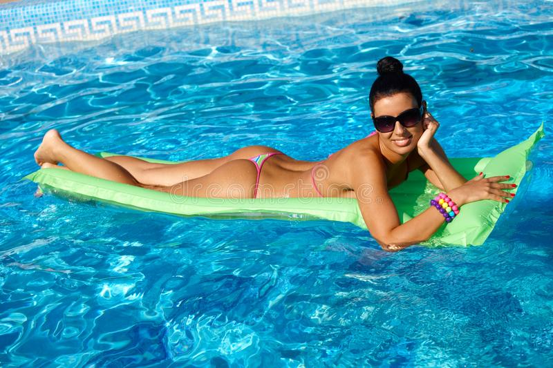 Beautiful woman on airbed at summertime