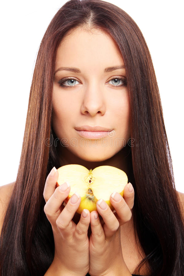 Beautiful woman with apple in hands stock photos