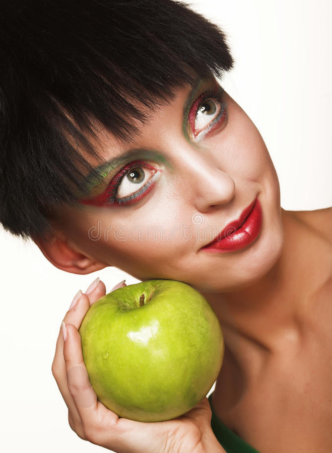 Beautiful woman with apple. Isolated on white stock photo